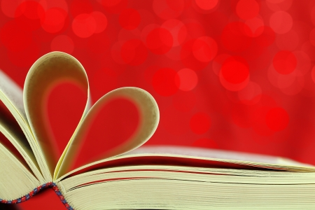 february 14: Selective focus image of book pages into a heart shape  Stock Photo