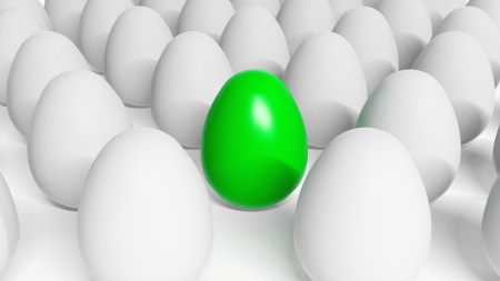 different concept: Green Easter egg among white eggs