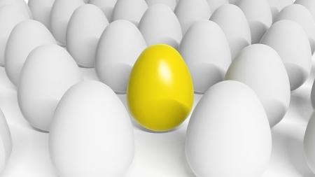 Yellow Easter egg among white eggs  Stock Photo