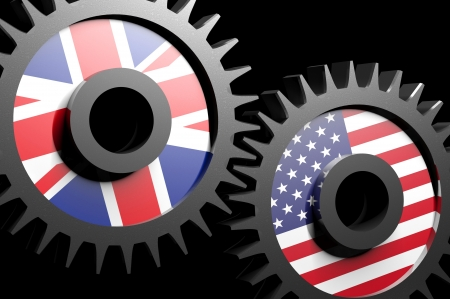 Two gears with the flags of USA and UK Stock Photo - 15962203
