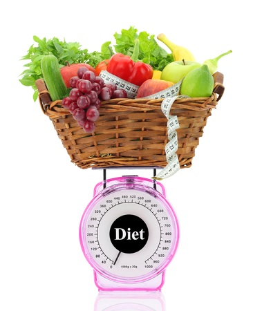 kitchen scale: Diet concept. Kitchen scale with fruits and vegetables Stock Photo