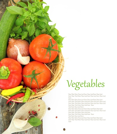 Fresh vegetables in wicker basket photo