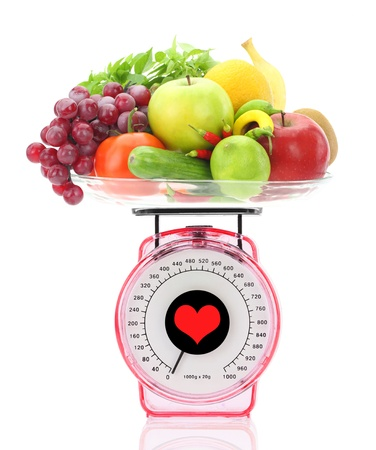 red gram: Healthy eating. Kitchen scale with fruits and vegetables Stock Photo