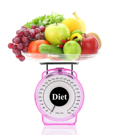 Diet concept. Kitchen scale with fruits and vegetables Stock Photo