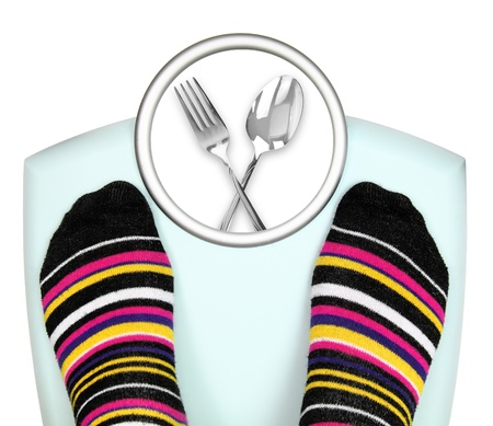 low calories: Woman s feet on weighing scale  Stock Photo