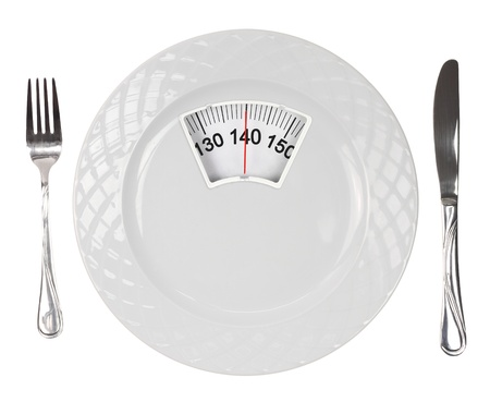 low fat diet: White plate with weight scale