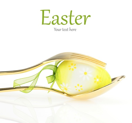 gold egg: Easter menu. Spoon with fork and Easter egg