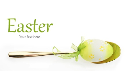 luxury restaurant: Easter menu. Spoon with Easter egg