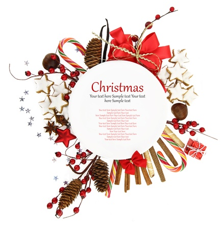 christmas frame: White Christmas plate with ornaments and candies  Stock Photo