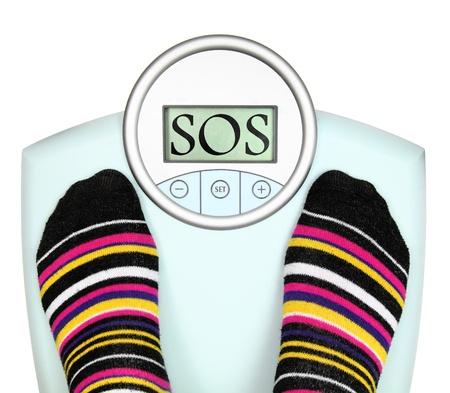 obesidad: Woman 's pies en b�scula