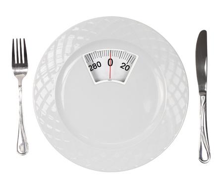 obesidad: Dieta comida. Placa blanca con la escala del peso