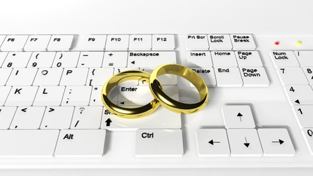 internet dating: Wedding rings on the keyboard