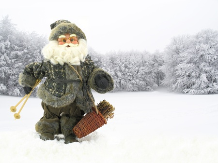 Santa Claus skier in snowy forest photo