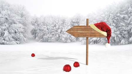 wintry landscape: Wooden sign with Santa hat on snowy field  Stock Photo