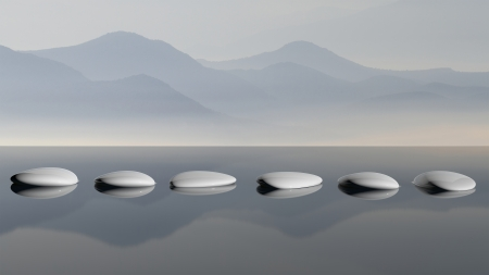 zen water: Scenic view of lake with mountain reflections and Zen stones in the water