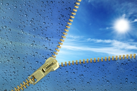 optimistic: Unzipped glass with water drops revealing blue sky  Stock Photo