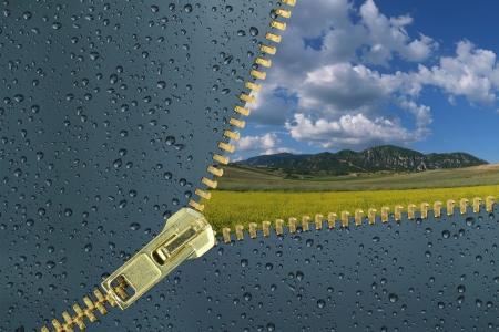 unzipped: Unzipped glass with water drops revealing beautiful landscape