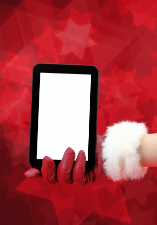 Woman's hand with red glove holding a tablet pc photo
