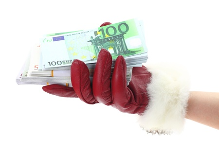 profit celebration: Womans hand with red glove holding gift of money