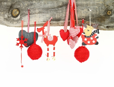 Christmas ornaments hanging on a wooden background Stock Photo - 16567021