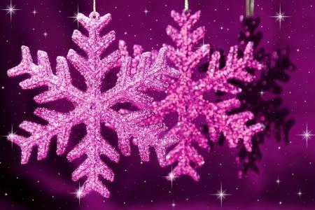 Christmas snowflakes on purple background photo