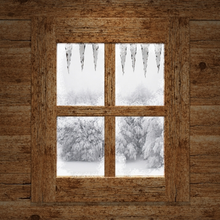 hut: Wooden window overlook the trees covered of snow  Stock Photo