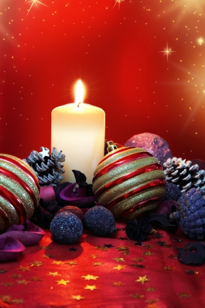 Christmas composition with candle and colored potpourri Stock Photo - 16698851