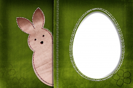 Easter bunny on textile background with space for your text photo