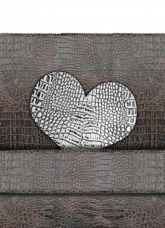Heart shape on leather background photo