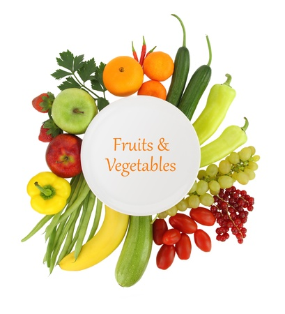 Empty plate with fruits and vegetables around it Stock Photo