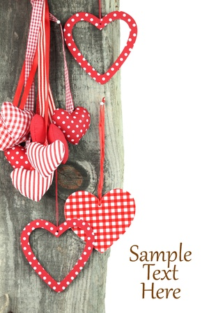 february 14: Heart ornaments hanging on a tree