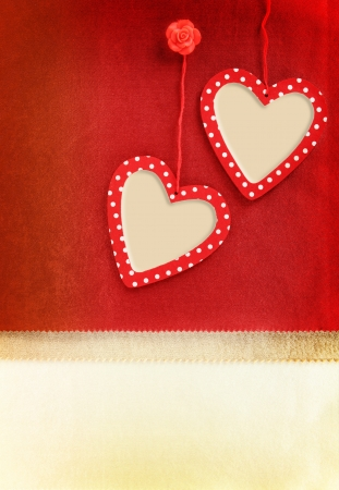 Heart ornament hanging on vintage fabric background photo