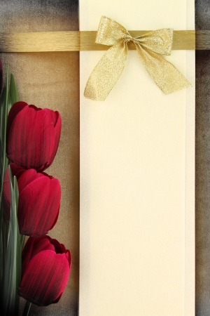 invitation background: Empty banner and red tulips on vintage background