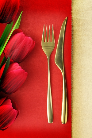 holiday catering: Fork and spoon on vintage menu background Stock Photo