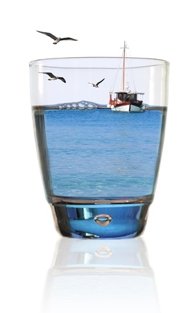 Glass of summer. Fishing boat in a glass of water photo