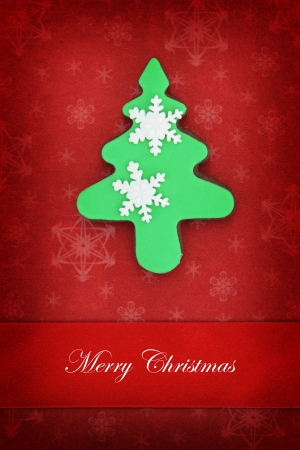Christmas card with tree cookie on red background  photo