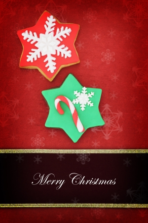 Christmas card with star cookies on red background  photo