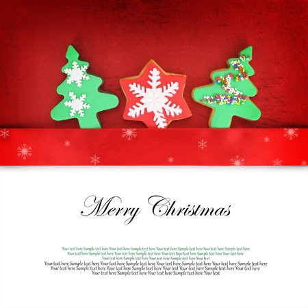 Christmas card with cookies on fabric background photo