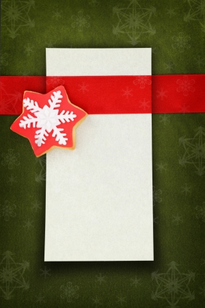 Christmas card with star cookie on fabric background photo