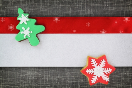 Christmas banner with cookies on fabric background photo