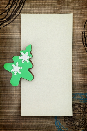 Christmas card with tree cookie on fabric background photo