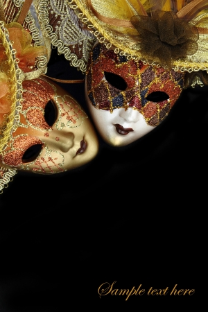 Vintage carnival masks on black background with copy-space Stock Photo