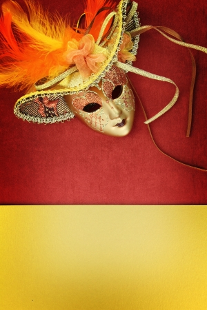 Vintage carnival mask on yellow background photo