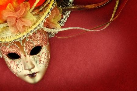 Vintage carnival mask on red background