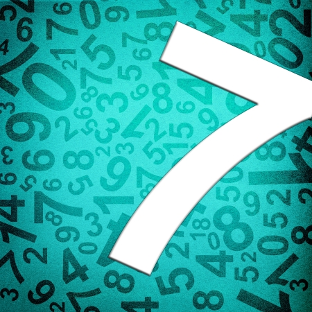 Number seven on fabric texture background photo