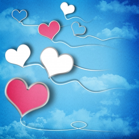 Valentines day background with heart shaped kites in the sky photo