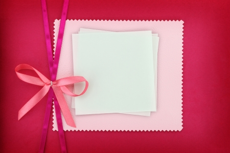 Empty card on pink fabric texture photo