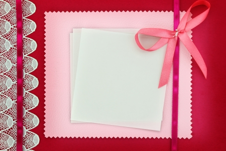 announcements: Empty card on pink fabric texture