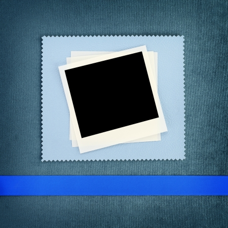 anniversary wishes: Photo frame on blue fabric background Stock Photo