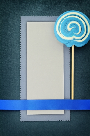 Blank banner with lollipop on blue background photo